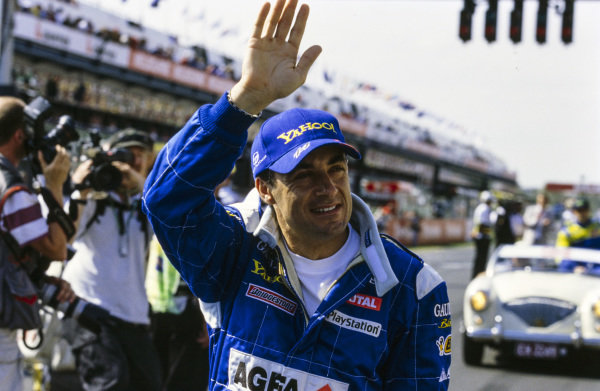 Jean Alesi waves to fans during the drivers' parade.