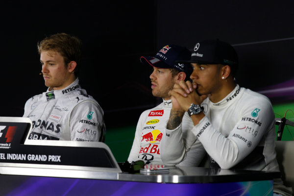 Buddh International Circuit, New Delhi, India. Saturday 26th October 2013. Nico Rosberg, Mercedes AMG, Sebastian Vettel, Red Bull Racing, and Lewis Hamilton, Mercedes AMG, in the post qualifying Press Conference. World Copyright: Charles Coates/LAT Photographic. ref: Digital Image _N7T3605