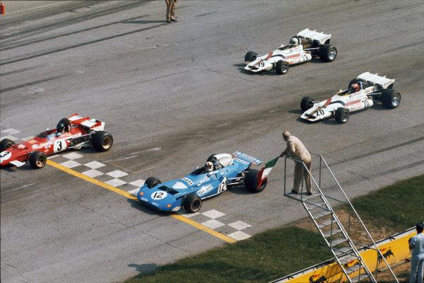 1971 Italian Grand Prix.  Monza, Italy. 3rd-5th September 1971.  Jacky Ickx, Ferrari 312B, leads Chris Amon, Matra MS120B, Jo Siffert, BRM P160, and Howden Ganley, BRM P160, as the Italian flag falls at the start.  Ref: 71ITA57. World Copyright: LAT Photographic