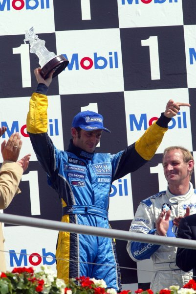 Jarno Trulli (ITA) Renault celebrates his third position on the podium.