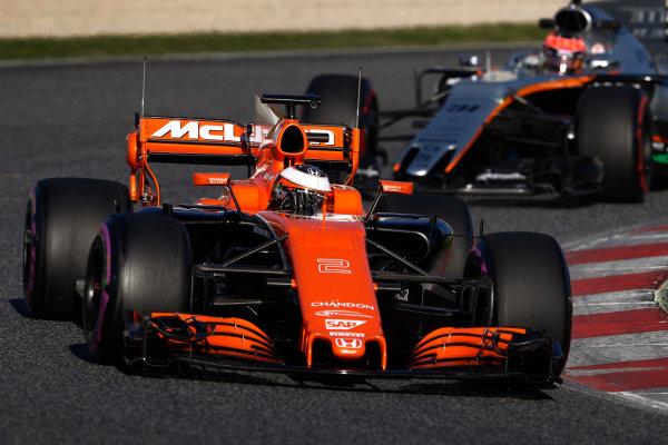 Circuit de Barcelona Catalunya, Barcelona, Spain. Tuesday 07 March 2017. Stoffel Vandoorne, McLaren MCL32 Honda, leads Esteban Ocon, Force India VJM10 Mercedes. World Copyright: Glenn Dunbar/LAT Images ref: Digital Image _31I5254
