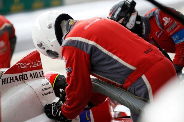 2014 Le Mans 24 Hours. Circuit de la Sarthe, Le Mans, France. Saturday 14 June 2014. Rene Rast (DEU), Jan Charouz (CZE), Vincent Capillaire (FRA) - Sebastien Loeb Racing, Oreca 03-Nissan, makes a stop Photo: Sam Bloxham/LAT ref: Digital Image _SBL1313
