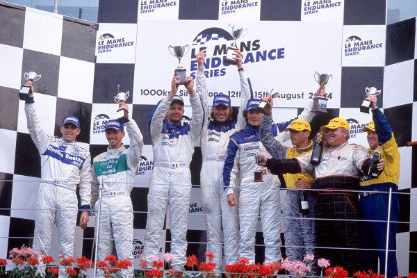 2004 Le Mans Endurance SeriesSilverstone 1000 KilometersSilverstone, England. 12th - 14th August 2004LMP2 Podium - Winners Gounon/Frei/Hancock (Courage C65-AER), 2nd placed J-B Bouvet/J-R Fournoux (WR WR V6) and 3rd placed Favre/Ricard/Fargier (Lucchini SR2-ALFA).World Copyright: Glenn Dunbar/LAT Photographicref: 35mm Transparency A39