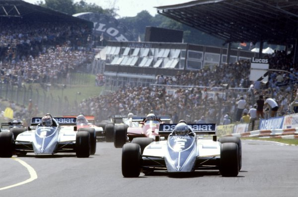 1982 British Grand Prix.Brands Hatch, Great Britain. 18 July 1982.Riccardo Patrese, Brabham BT50-BMW, retired, leads Nelson Piquet, Brabham BT50-BMW, retired, and Didier Pironi, Ferrari 126C2, 2nd position, at the start, action.World Copyright: LAT PhotographicRef: 35mm transparency 82GB42