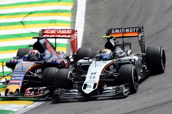 Max Verstappen (NED) Scuderia Toro Rosso STR10 battles with Sergio Perez (MEX) Force India VJM08 at Formula One World Championship, Rd18, Brazilian Grand Prix, Race, Interlagos, Sao Paulo, Brazil, Sunday 15 November 2015. BEST IMAGE