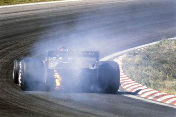 Mario Andretti is forced to retire after a broken valve on the engine of his Lotus 79 Ford.