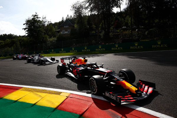 Max Verstappen, Red Bull Racing RB16, leads Pierre Gasly, AlphaTauri AT01, and Lance Stroll, Racing Point RP20