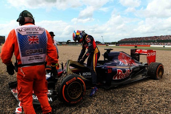 The car of Max Verstappen (NED) Scuderia Toro Rosso STR10 is recovered after crashing into the gravel at Formula One World Championship, Rd9, British Grand Prix, Race, Silverstone, England, Sunday 5 July 2015.