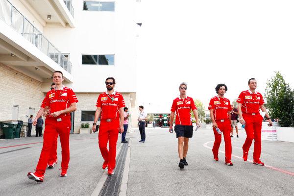 Circuit of the Americas, Austin, Texas, United States of America. Thursday 19 October 2017. Sebastian Vettel, Ferrari, with his team. World Copyright: Sam Bloxham/LAT Images  ref: Digital Image _W6I1586