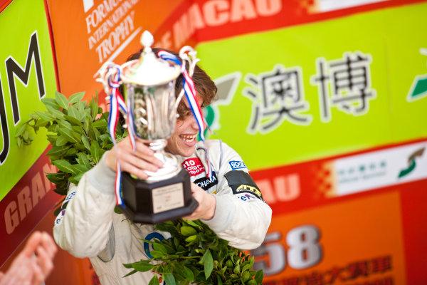 Formula Three. 16th - 19th November 2011. Circuit de Guia, Macau. Roberto Merhi, Prema Powerteam celebrates on the podium after the qualifying race. Portrait. World Copyright: Drew Gibson/LAT Photographic. ref: Digital Image _Y2Z6359