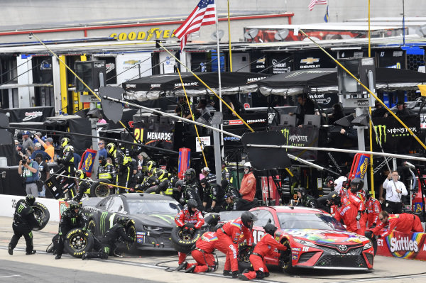 #18: Kyle Busch, Joe Gibbs Racing, Toyota Camry Skittles and #1: Kurt Busch, Chip Ganassi Racing, Chevrolet Camaro Monster Energy, makes a pit stop
