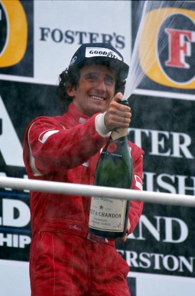 Race winner Alain Prost (FRA) Ferrari celebrates and sprays the champagne Formula One World Championship, Rd8, British Grand Prix, Silverstone, England, 15 July 1990.