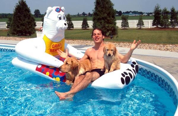 Jacques Villeneuve (CDN) relaxes in his pool with two dogs.  Indycar Drivers at Home Feature. Catalogue Ref.: 15-174 Sutton Motorsport Images Catalogue