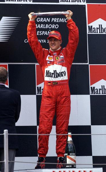 2001 Spanish Grand PrixCatalunya, Barcelona, Spain. 27-29 April 2001.Michael Schumacher (Ferrari) celebrates his 1st position on the podium.World Copyright - Steve Etherington/LAT Photographicref: 18 mb Digital Imagecelebrating