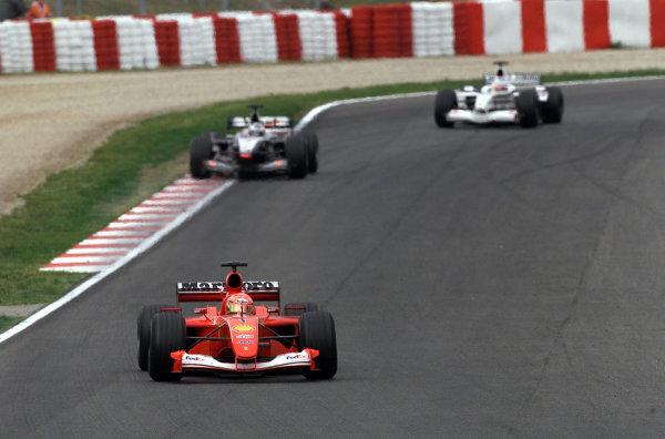 2001 Spanish Grand PrixCatalunya, Barcelona, Spain. 27-29 April 2001.Michael Schumacher (Ferrari F2001) followed by David Coulthard (McLaren MP4/16 Mercedes) and Olivier Panis (B.A R. 003 Honda).World Copyright - Steve Etherington/LAT Photographicref: 18 mb Digital Image
