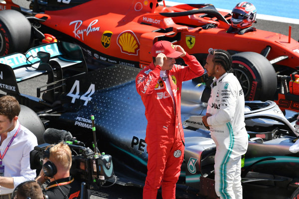 Charles Leclerc, Ferrari, talks with pole man Lewis Hamilton, Mercedes AMG F1