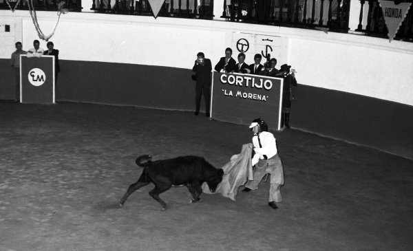 Jim Clark (GBR) Lotus tries his hand at Bull Fighting. Formula One World Championship, Rd11, Mexican Grand Prix, Mexico City, 22 October 1967. BEST IMAGE
