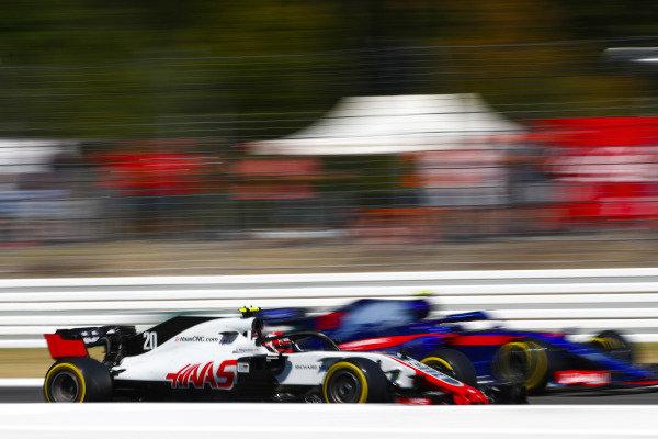 Kevin Magnussen, Haas F1 Team VF-18 Ferrari, and Pierre Gasly, Toro Rosso STR13 Honda.