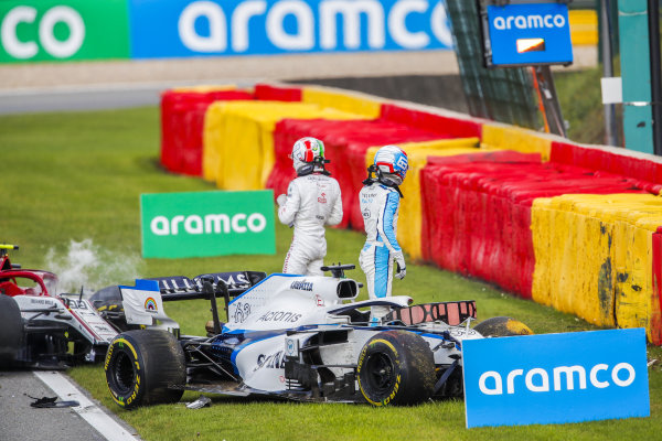 George Russell, Williams FW43 and Antonio Giovinazzi, Alfa Romeo Racing C39, both start to exit their cars after a collision on track