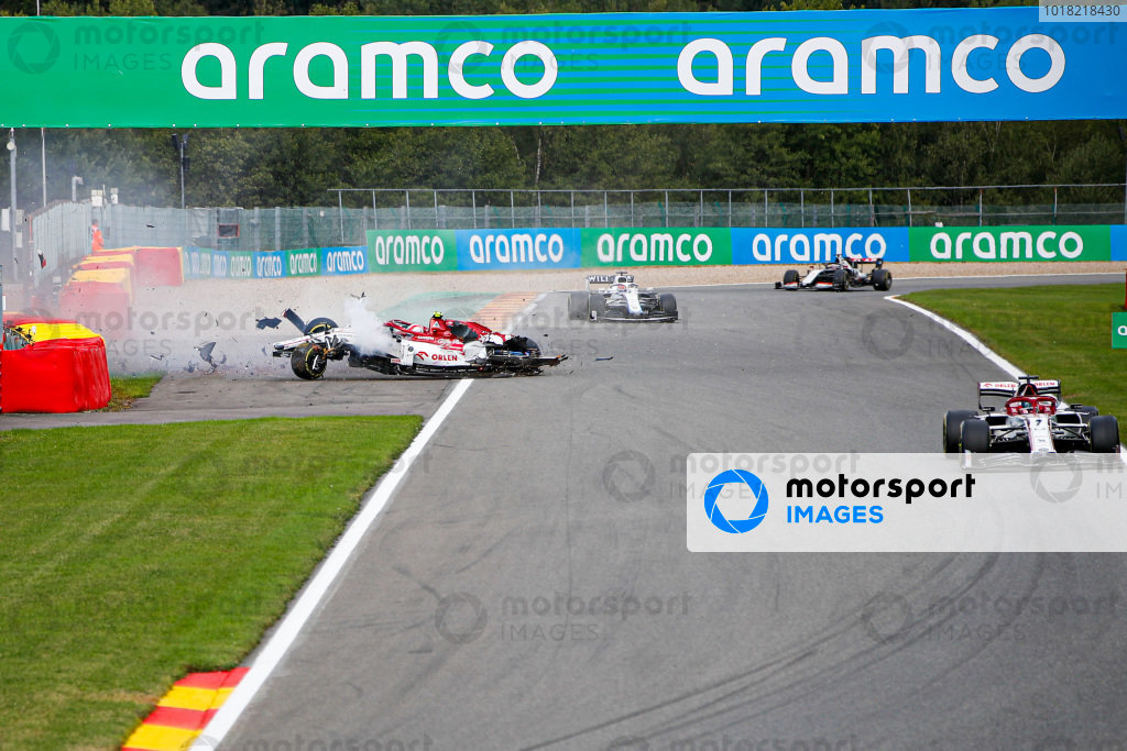 Antonio Giovinazzi, Alfa Romeo Racing C39 collides with the barrier and his loose tyre hits the car of George Russell, Williams FW43