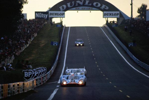 Richard Attwood / Herbert Mueller, J. W. Automotive Engineering, Porsche 917 K, leads Helmut Marko / Gijs van Lennep, Martini International Racing Team, Porsche 917 K.