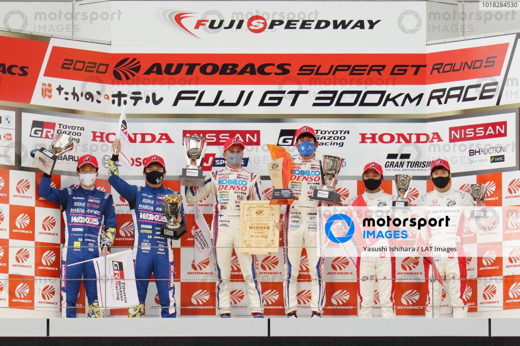 GT500 Winners Heikki Kovalainen & Yuichi Nakayama ( #39 DENSO KOBELCO SARD GR Toyota Supra ) celebrate on the podium with their trophies. Alongside are second position Kazuya Oshima & Sho Tsuboi ( #14 WAKO'S 4CR GR Toyota Supra ) and third position Tomoki Nojiri & Nirei Fukuzumi ( #8 ARTA Honda NSX-GT )