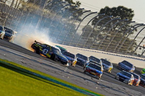 14 February, 2010, Daytona Beach, Florida USA USAA J. Allmendinger (#43) spins in front of Kyle Busch (#18) after hitting the wall exiting turn 2.©F. Peirce Williams 2010 USALAT Photographic