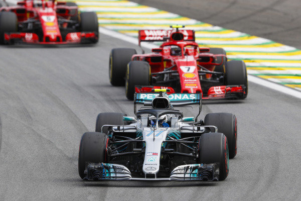 Valtteri Bottas, Mercedes AMG F1 W09 EQ Power+, leads Kimi Raikkonen, Ferrari SF71H, and Sebastian Vettel, Ferrari SF71H