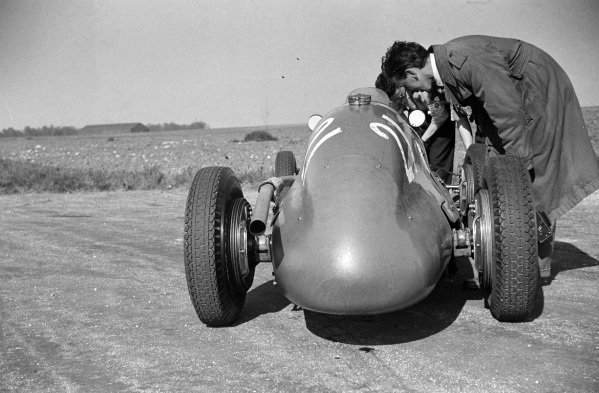 """The car of """"B. Bira"""", Maserati 4CLT/48, is inspected after stopping."""