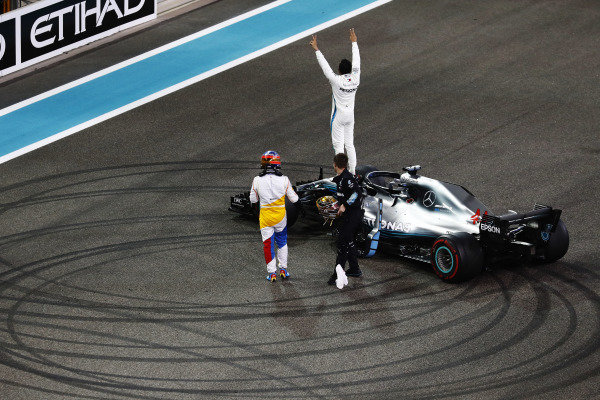 Lewis Hamilton, Mercedes AMG F1 W09 EQ Power+, celebrates on his car as he is congratulated by Fernando Alonso, McLaren, on the grid