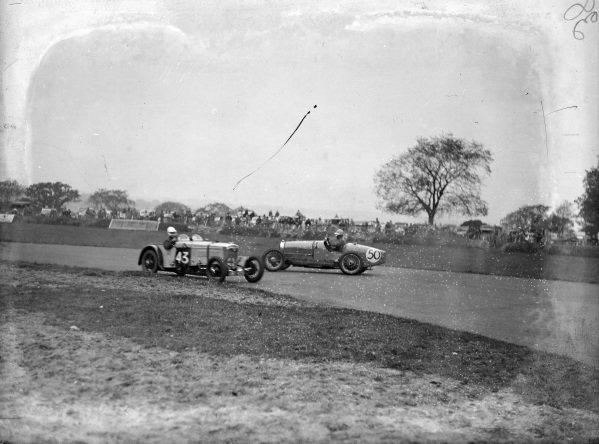G. Casswell, Frazer Nash, passes T. K. Humber, Bugatti, who has spun.