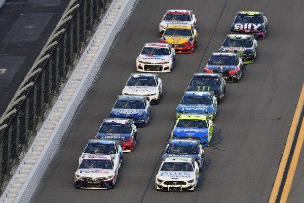 #11: Denny Hamlin, Joe Gibbs Racing, Toyota Camry FedEx Express and #10: Aric Almirola, Stewart-Haas Racing, Ford Mustang Pure Farmland