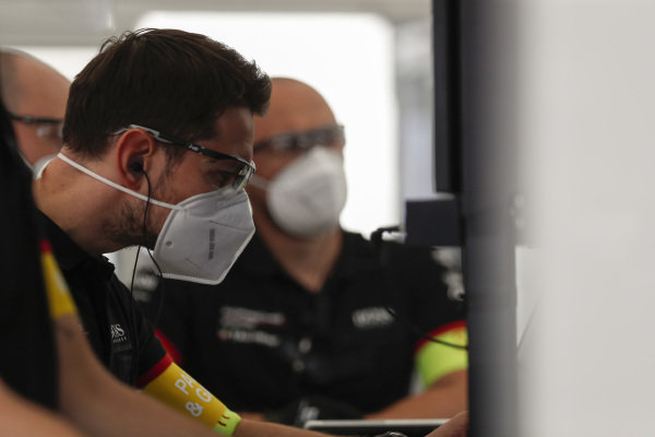 Tag Heuer Porsche team members at work in the garage