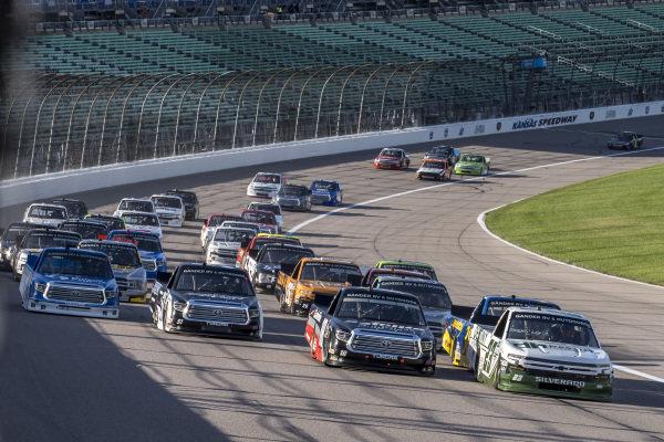 #18: Christian Eckes, Kyle Busch Motorsports, Safelite AutoGlass Toyota Tundra battles for the lead on the start
