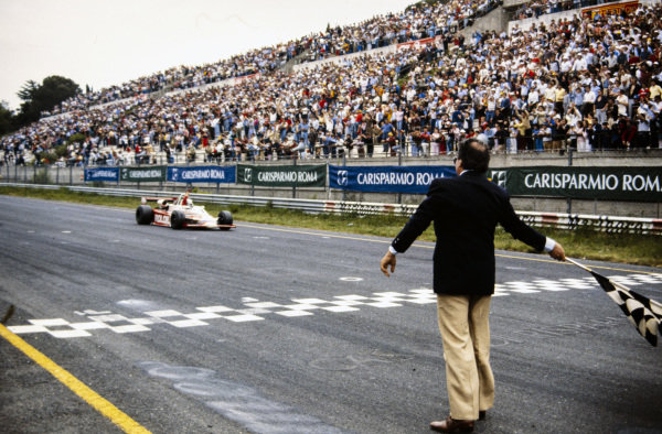 Beppe Gabbiani, March 832 BMW/Rosche, crosses the finish line and takes the chequered flag for victory.