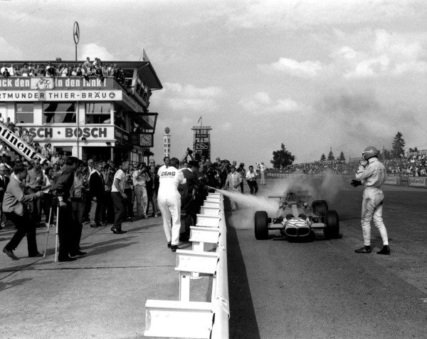 2003 Racing Past. . Exhibition1969 German Grand Prix, Nurburgring. Rolf Stommelen watches his F2 Lotus 59B-Cosworth smoke after finishing.World Copyright - LAT PhotographicExhibition ref: a075