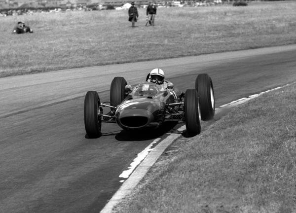 John Surtees (GBR) Lola Mk4, who finished second, uses all the road and more. British Grand Prix, Aintree, 21 July 1962.