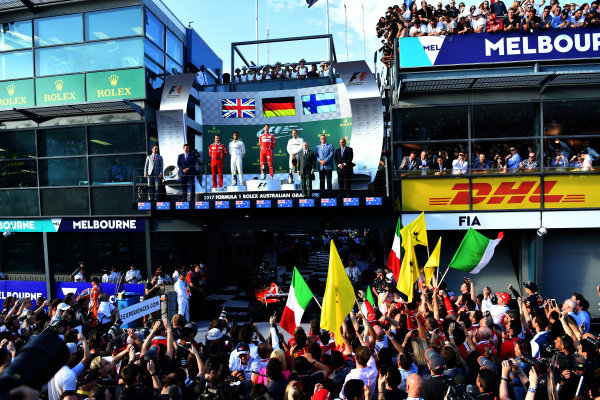 (L to R): Lewis Hamilton (GBR) Mercedes AMG F1, Luigi Fraboni (ITA) Ferrari Head of Engine Trackside Operations, race winner Sebastian Vettel (GER) Ferrari and Valtteri Bottas (FIN) Mercedes AMG F1 on the podium at Formula One World Championship, Rd1, Australian Grand Prix, Race, Albert Park, Melbourne, Australia, Sunday 26 March 2017.