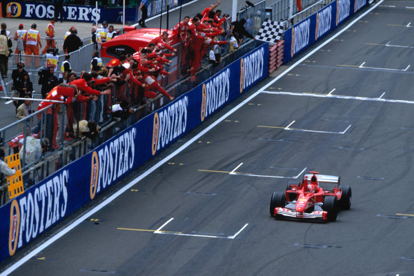 2004 British Grand Prix Silverstone England. 9th - 11th July. Michael Schumacher, Ferrari F2004 crosses the line to take his 80th Grand Prix victory. Action.  World Copyright:Steven Tee/LAT Photographi--c  Ref:35mm image A20
