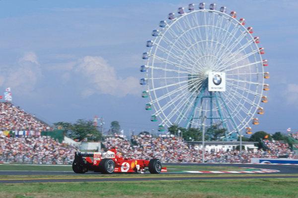 2004 Japanese Grand Prix. Suzuka , Japan 8th - 10th October 2004 Michael Schumacher, Ferrari F2004. Action.  World Copyright:Steven Tee/LAT Photographic  Ref: 35mm Image: A10