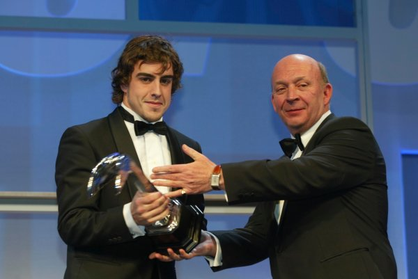 2003 AUTOSPORT AWARDS, The Grosvenor, London. 7th December 2003.Fernando Alonso is handed the Gregor Grant Award by Nigel Roebuck.Photo: Peter Spinney/LAT PhotographicRef: Digital Image only