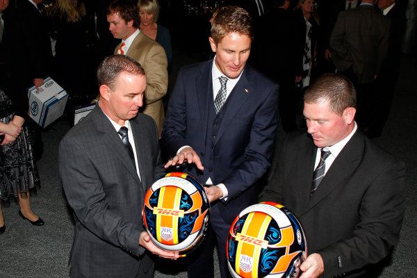 6 December, 2012, Indianapolis, Indiana USA Ryan Hunter-Reay presents his team with replicas of his helmet.(c)2012, Russell LaBounty LAT Photo USA .