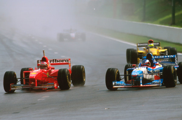 Spa-Francorchamps, Belgium.22-24 August 1997.Michael Schumacher (Ferrari F310B) dives down the inside of Jean Alesi (Benetton B197 Renault) at La Source to take second place.Ref-97 BEL 11.World Copyright - LAT Photographic