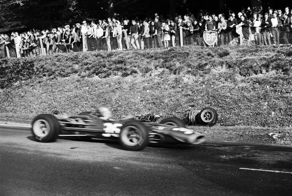 Piers Courage, BRM P126, passes the wreckage of Jo Schlesser's Honda RA302.