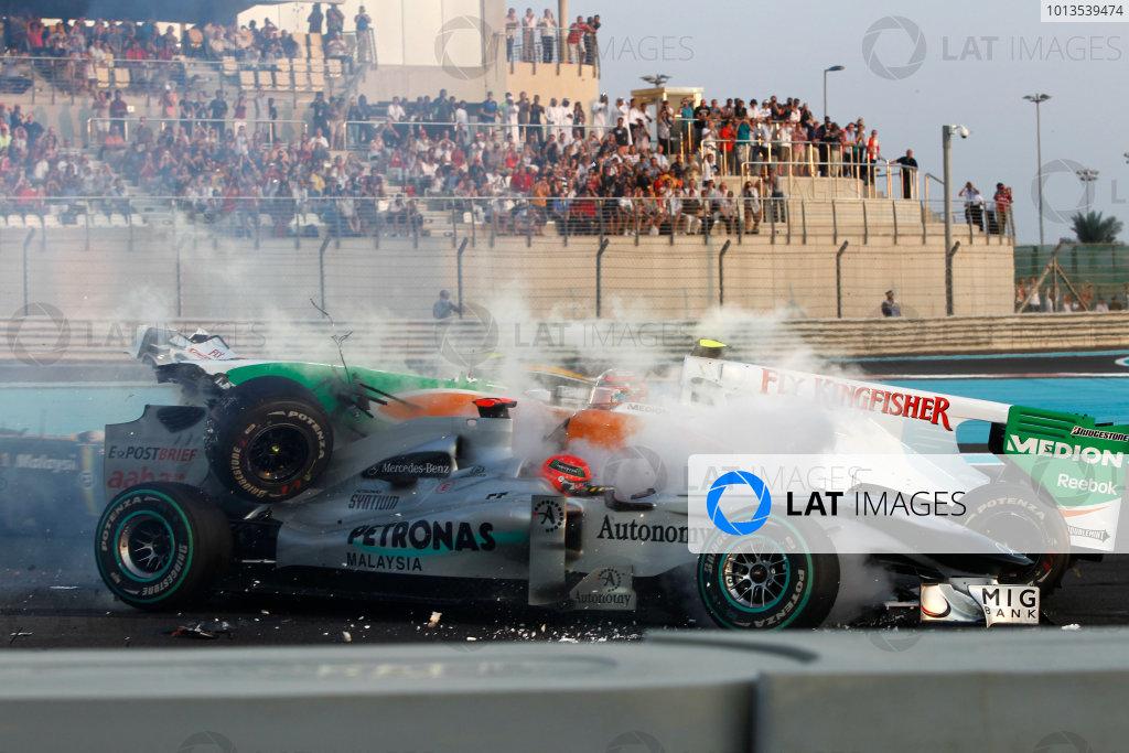 Yas Marina Circuit, Abu Dhabi, United Arab Emirates 14th November 2010. Vitantonio Liuzzi, Force India VJM03 Mercedes, retired, collides with Michael Schumacher, Mercedes GP W01, retired, on the opening lap. Action. Crashes. World Copyright: Andrew Ferraro/LAT Photographic  ref: Digital Image _Q0C6123