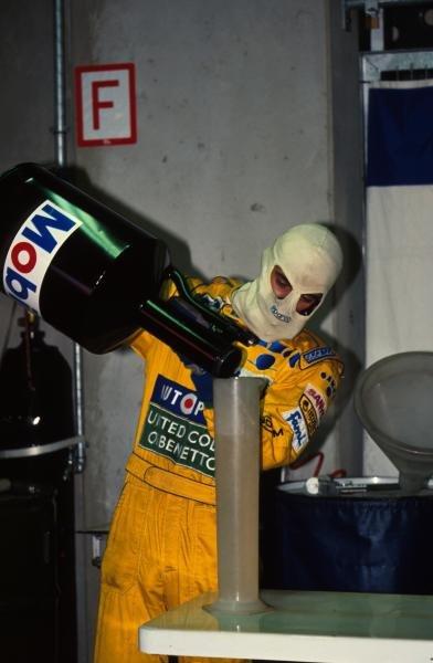 A Benetton mechanic measures out the race fuel. German Grand Prix, Hockenheim, 26 July 1992