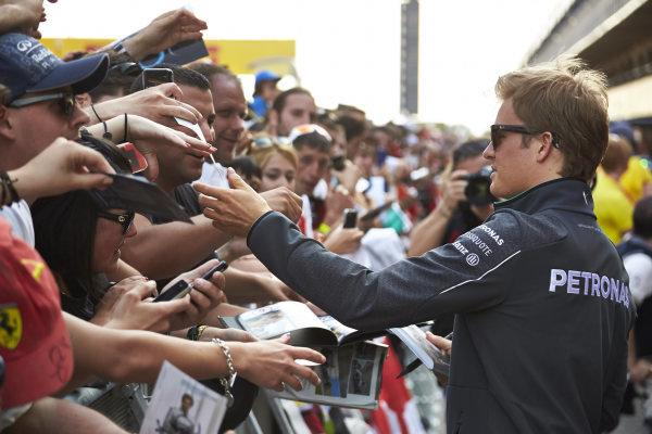 Circuit de Catalunya, Barcelona, Spain. Thursday 8 May 2014. Nico Rosberg, Mercedes AMG, signs autographs for fans. World Copyright: Steve EtheringtonLAT Photographic. ref: Digital Image SNE22264 copy