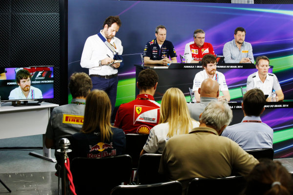 Interlagos, Sao Paulo, Brazil. Friday 7 November 2014. Jonathan Wheatley, Team Manager, Red Bull Racing, Pat Fry, Director of Chassis, Ferrari, Paul Hembrey, Director, Pirelli Motorsport, Rob Smedley, Head of Vehicle Performance, Williams F1, and Sam Michael, Sporting Director, McLaren, in the Team Principals Press Conference. World Copyright: Charles Coates/LAT Photographic. ref: Digital Image _N7T9430