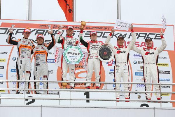 2015 Japanese Super GT Series. Okayama, Japan. 4th - 5th April 2015. Rd 1. GT300 Winner Koki Saga & Yuichi Nakayama ( #31 TOYOTA PRIUS apr GT ) 2nd position Shinichi Takagi & Takashi Kobayashi ( #55 ARTA CR-Z GT ) 3rd position Richard Lyons & Tomonobu Fujii ( #21 Audi R8 LMS ultra ) podium, portrait World Copyright: Yasushi Ishihara/LAT Photographic. Ref: Digital Image 2015SGT_Rd1_021