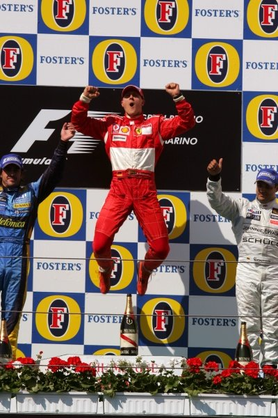 Race winner Michael Schumacher (GER) Ferrari on the podium. Formula One World Championship, Rd4, San Marino Grand Prix, Race Day, Imola, Italy, 23 April 2006.  DIGITAL IMAGE BEST IMAGE